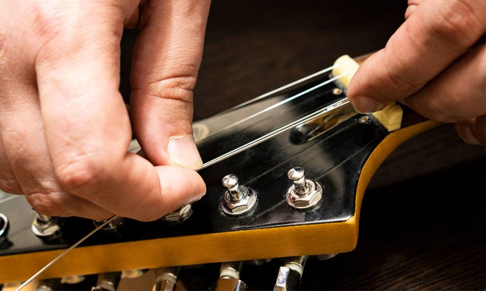 Change an Acoustic Guitar Strings